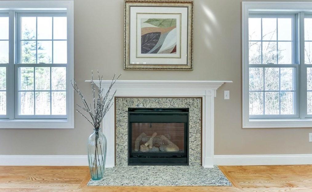Beautiful Granite Fireplace - Condo Staging - Interior Design in Hampden County