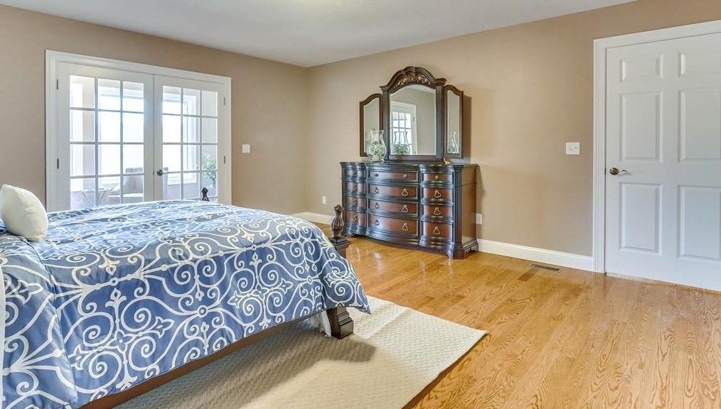 Large Master Bedroom Blue - Condo Staging - Massachusetts Interior Designer