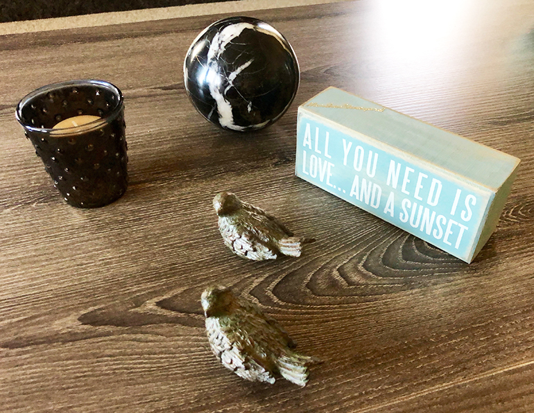 Add some small items on your coffee table - Details Full Service Interiors - Interior Design in Monson
