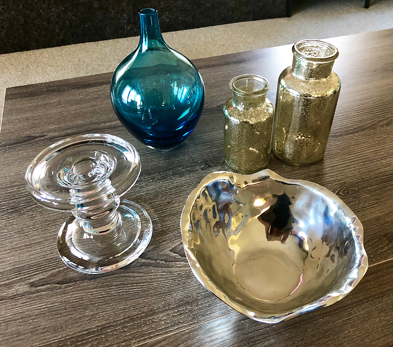 Coffee table accessories - What to put on your coffee table - Details Full Service Interiors - Interior Decorator in Monson