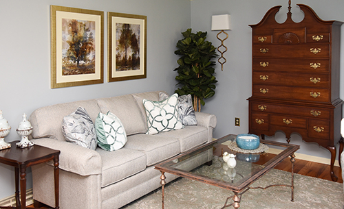 Traditional Living Room - Queen Anne Armoire - Gold Sconce - Blue Walls - Details Full Service Interiors - Monson Interior Decorating
